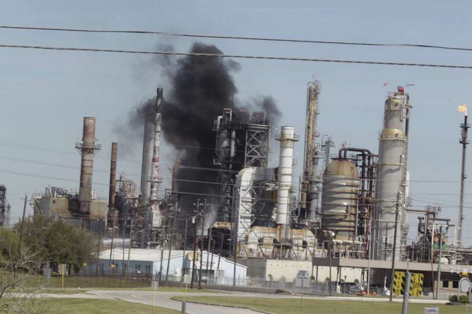 Smoke rises from a fire in 2016 at the Pasadena Refinery. It's one of five Texas polluters issued permits that a watchdog group says are confusing and difficult to enforce. The Environmental Integrity Project sued the U.S. Environmental Protection Agency over the permits on Thursday, July 20, 2017. Photo: James Nielsen | Houston Chronicle
