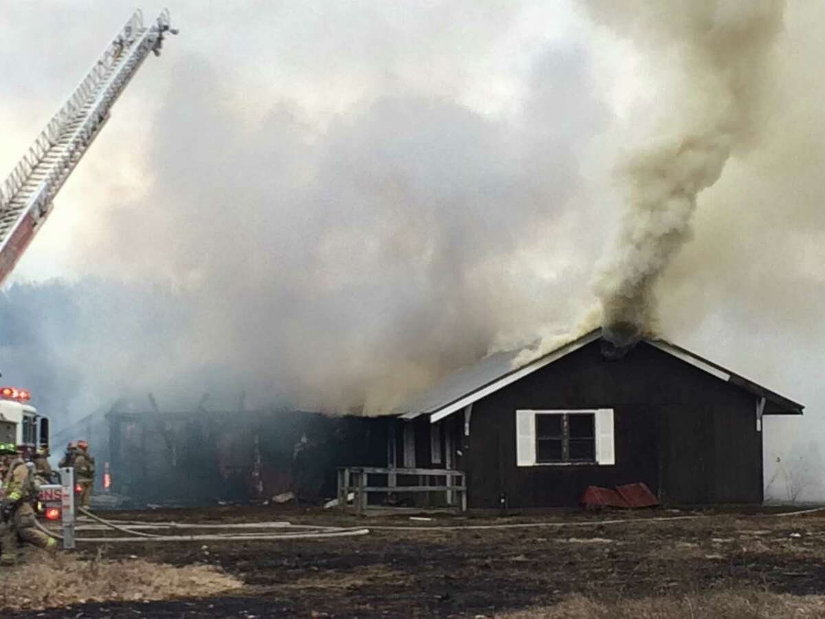 The former Round Lake Rod and Gun Club went up in flames on Saturday, March 5, 2016. (Leigh Hornbeck/Times Union)