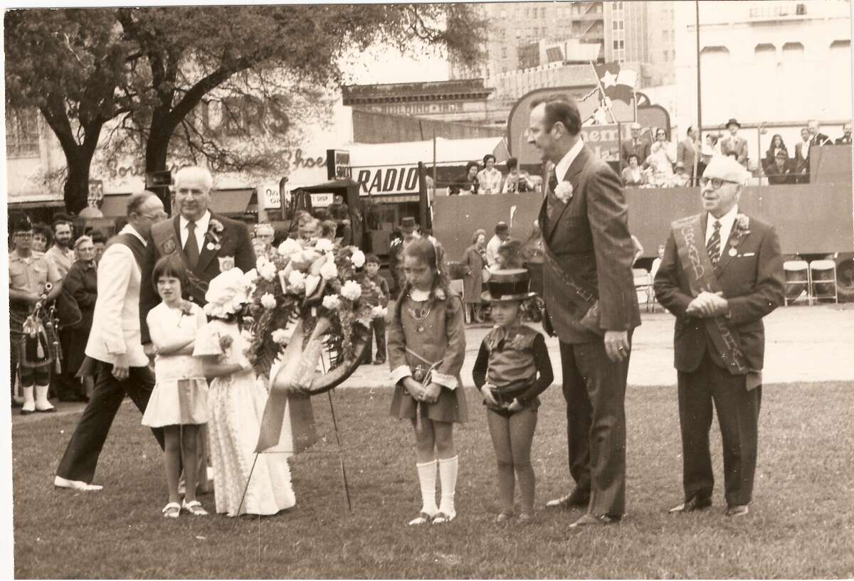 At an early 1970s St. Patrick's Day celebration, members of the Harp and Shamrock Society, officers and members' children lay a wreath in memory of Irish-born Alamo defenders.