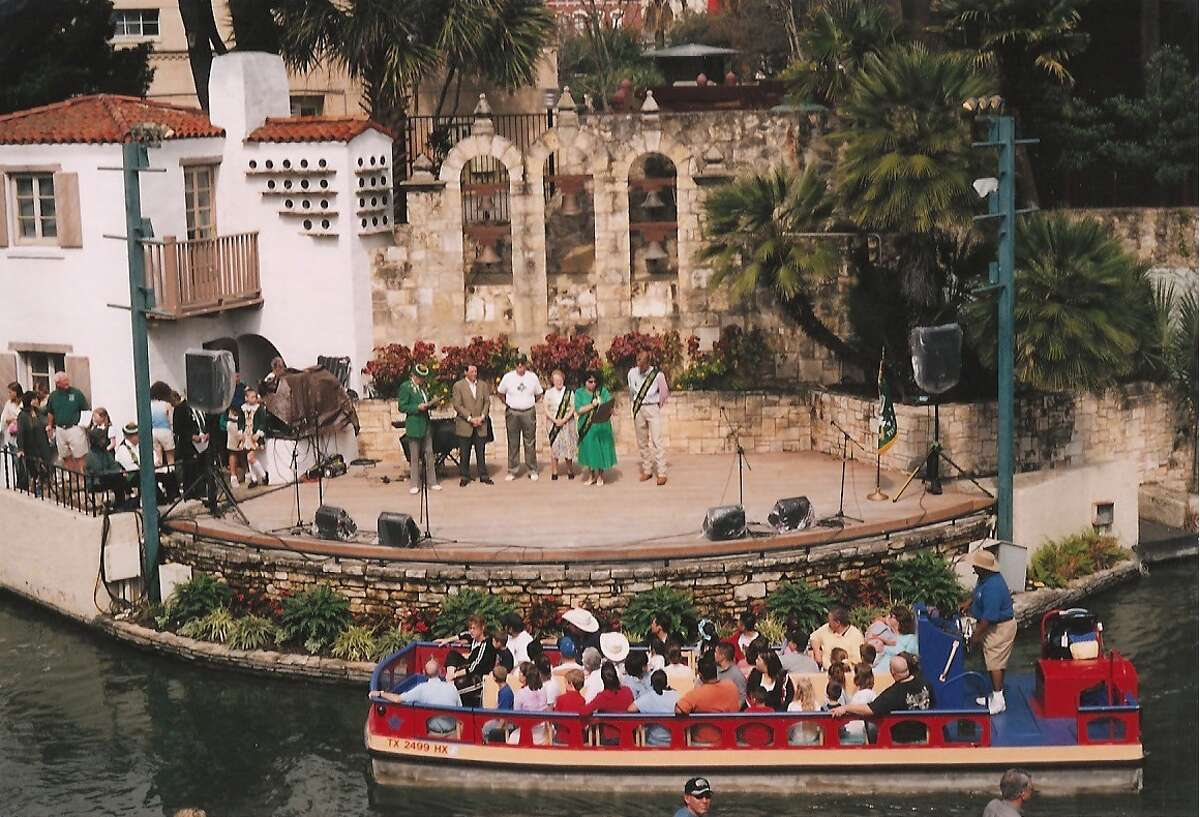 At Arneson River Theater in 2004, Olympic champion swimmer and native San Antonian Josh Davis (far right) serves as grand marshal of the St. Patrick's Day River Parade