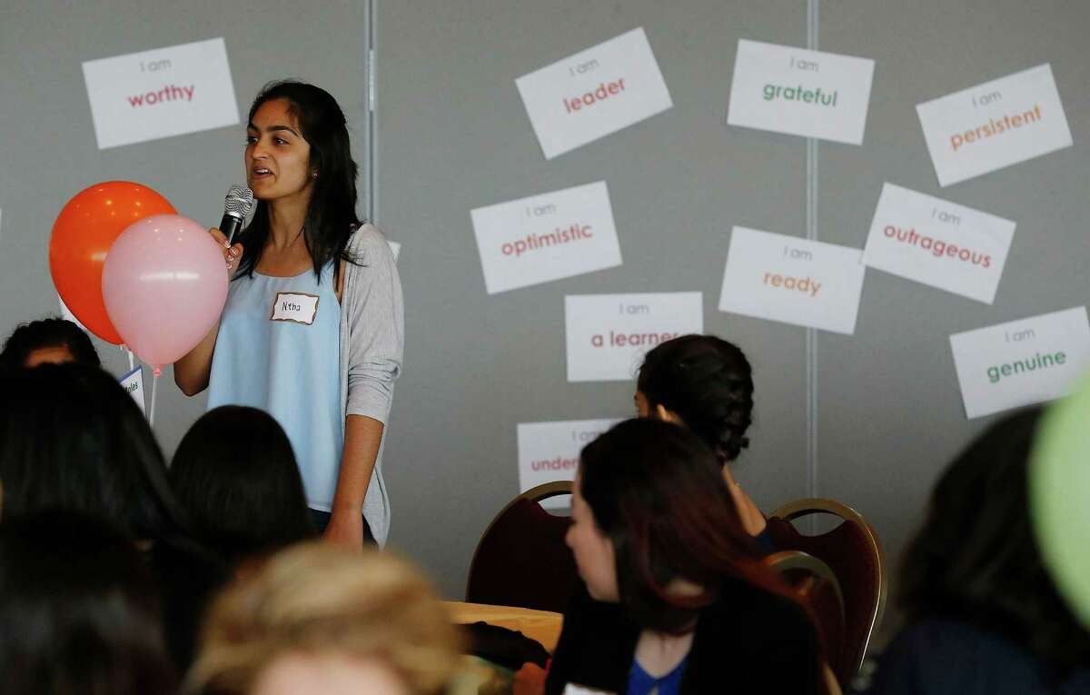 Neha Kapur, 15, of BASIS Charter School asks a question to a lecturer as over 200 young women from area middle and high schools take part in the Women's Global Connection's Girls Global Summit at University of the Incarnate Word last March. BASIS has two schools here and will expand to include grades K-4 starting this fall.