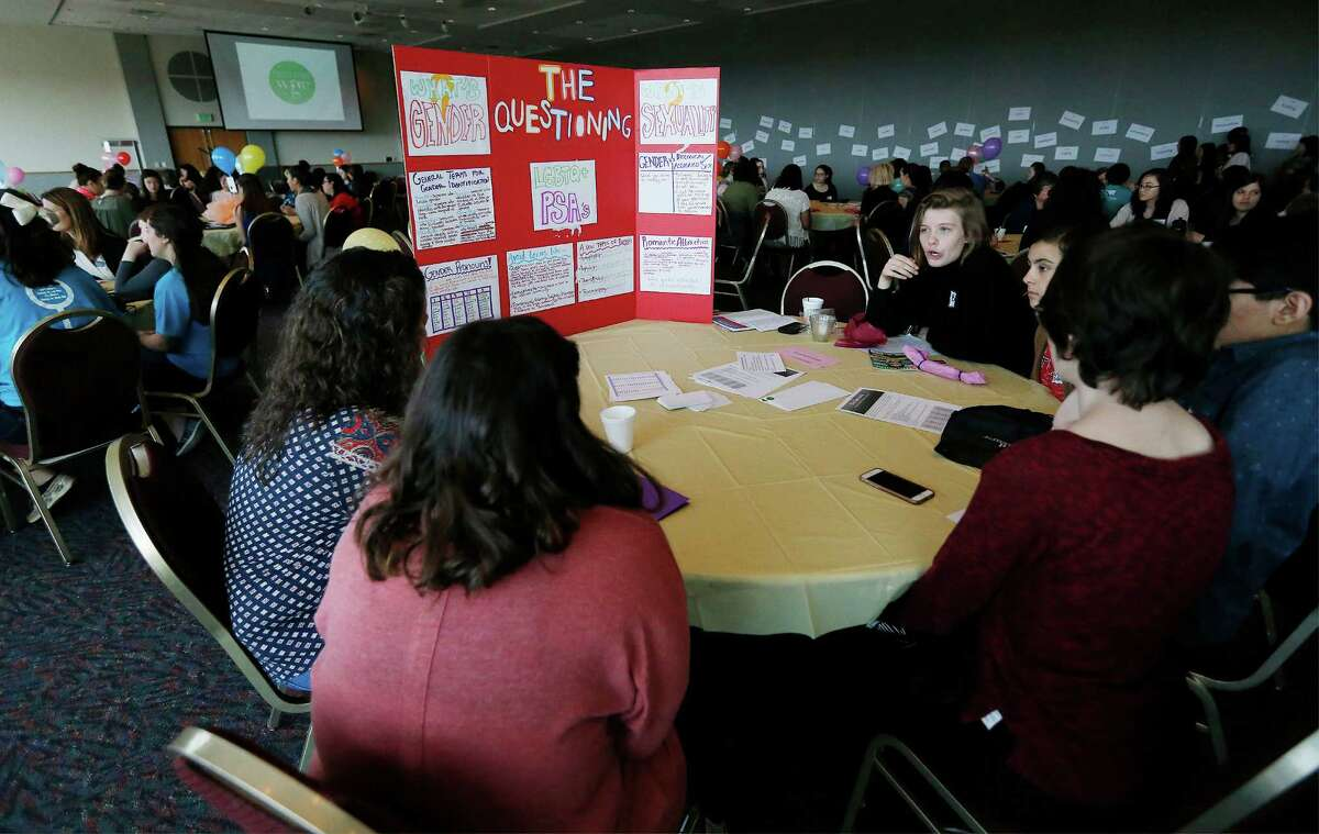 A group at a table discusses the topic of gender identity as over 200 young women from area middle and high schools take part in the Women's Global Connection's Girls Global Summit at University of the Incarnate Word on Saturday, Mar. 5, 2016. Participants listened to motivational lectures and took part in interactive discussions which encouraged empathy on issues facing women around the world. (Kin Man Hui/San Antonio Express-News)
