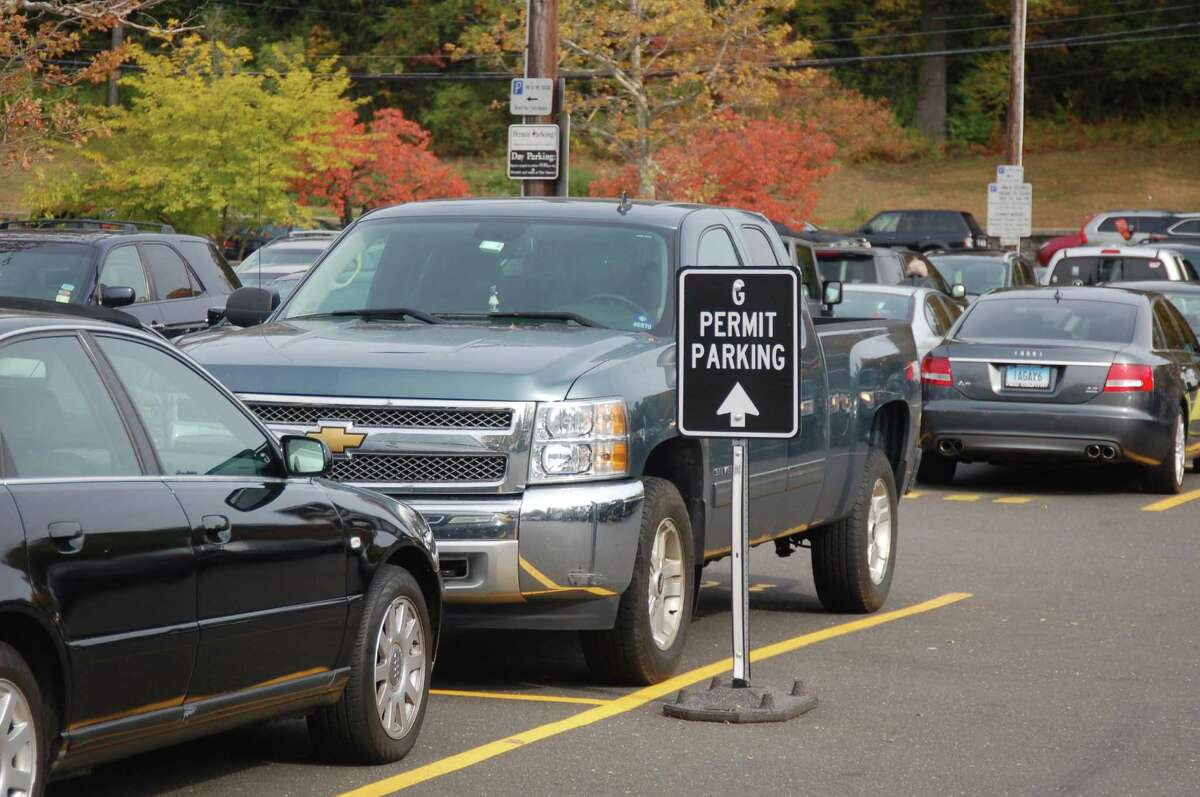 Cars are parked at the Island Beach parking lot. Residents can now alert Town Hall to parking issues on the Access Greenwich mobile app.
