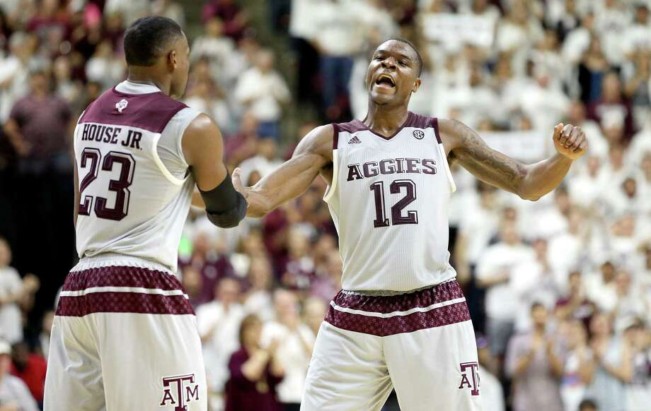 Texas A&M's Jalen Jones (right) reacts with teammate Danuel House as a timeout is called against Vanderbilt during the second half on March 5, 2016, in College Station. Photo: Sam Craft /AP / FR145148 AP
