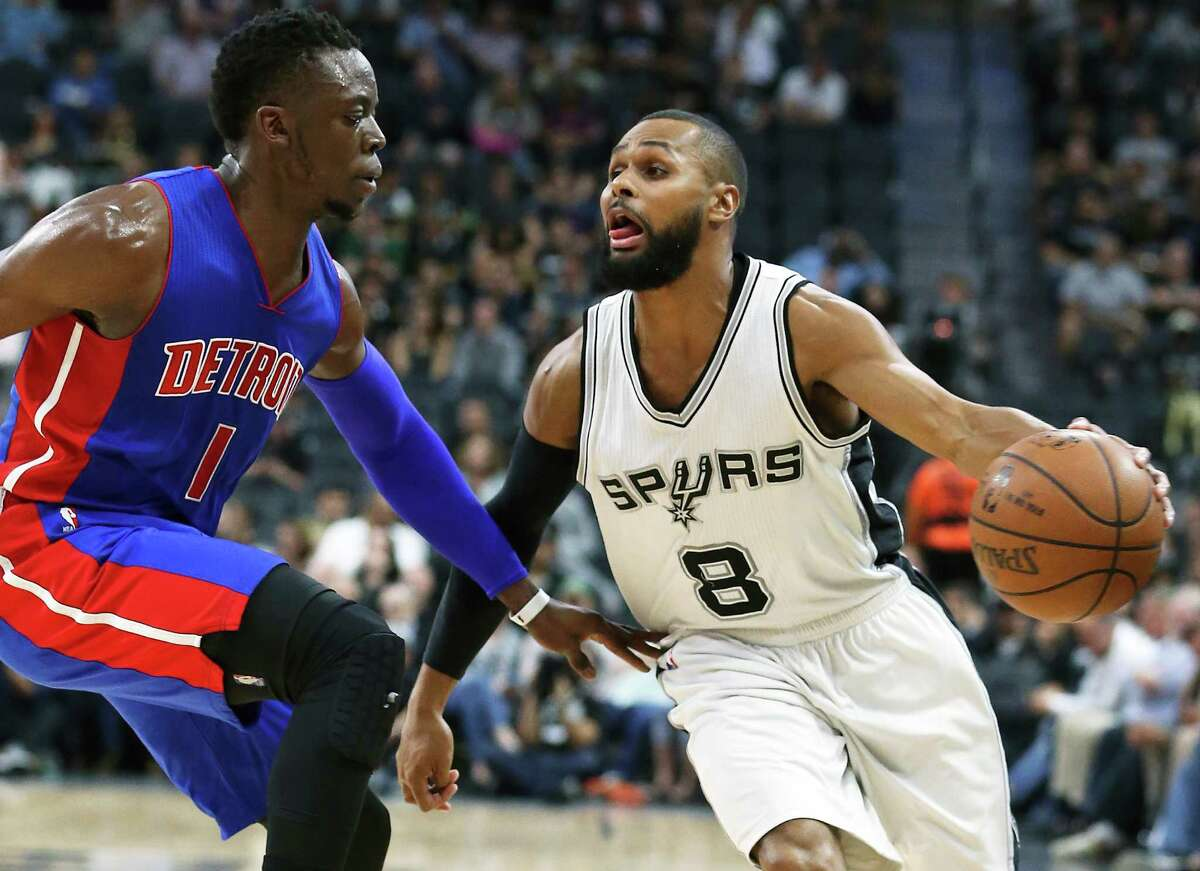 Patty Mills drives against Reggie Jackson as the Spurs host the Pistons at the AT&T Center on March 2, 2016.