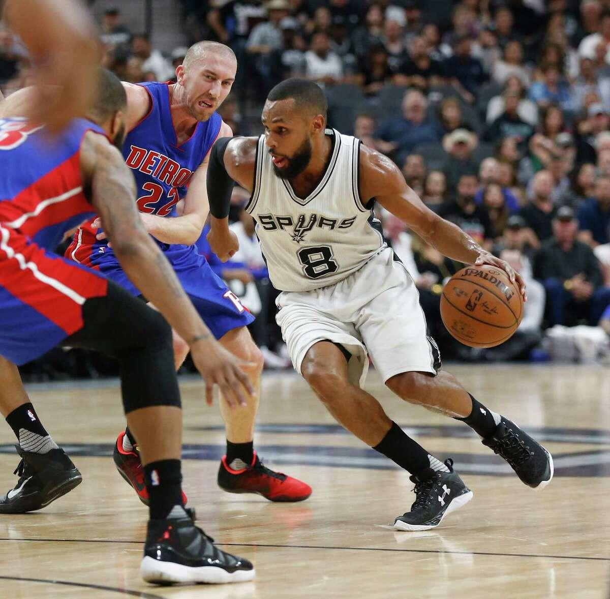 Spurs' Patty Mills (08) maneuvers around Detroit Pistons' Steve Blake (22) at the AT&T Center on Wednesday, Mar. 2, 2016. (Kin Man Hui/San Antonio Express-News)