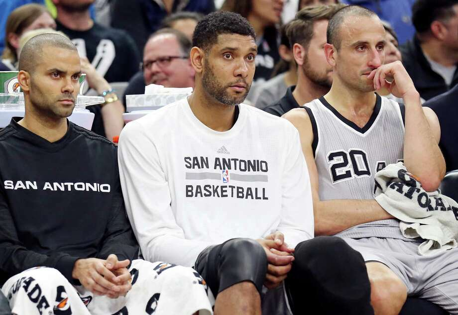 Spurs' Tony Parker (from left), Tim Duncan, and Manu Ginobili watch second-half action against the Boston Celtics from the bench on Dec. 5, 2015 at the AT&T Center. Photo: Edward A. Ornelas /San Antonio Express-News / © 2015 San Antonio Express-News