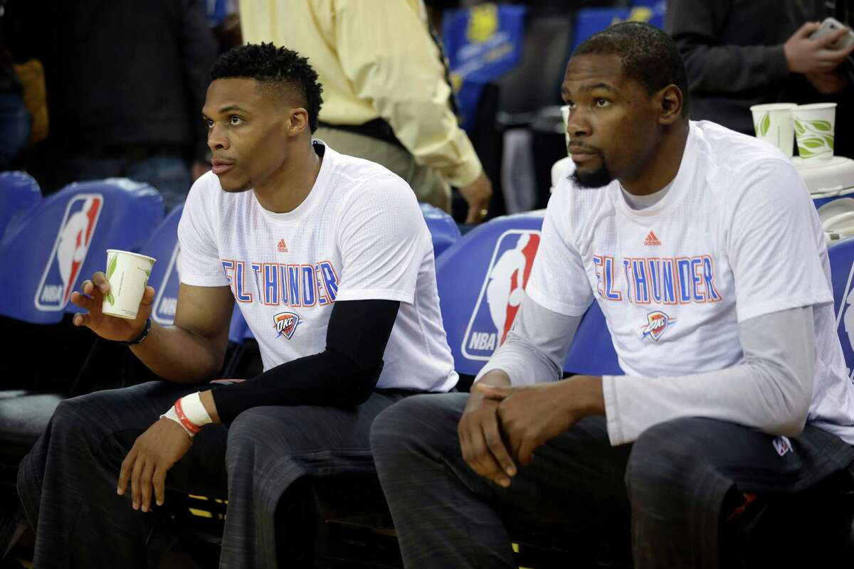 Oklahoma City Thunder's Russell Westbrook and Kevin Durant during an game against the Golden State Warriors on March 3, 2016, in Oakland, Calif.