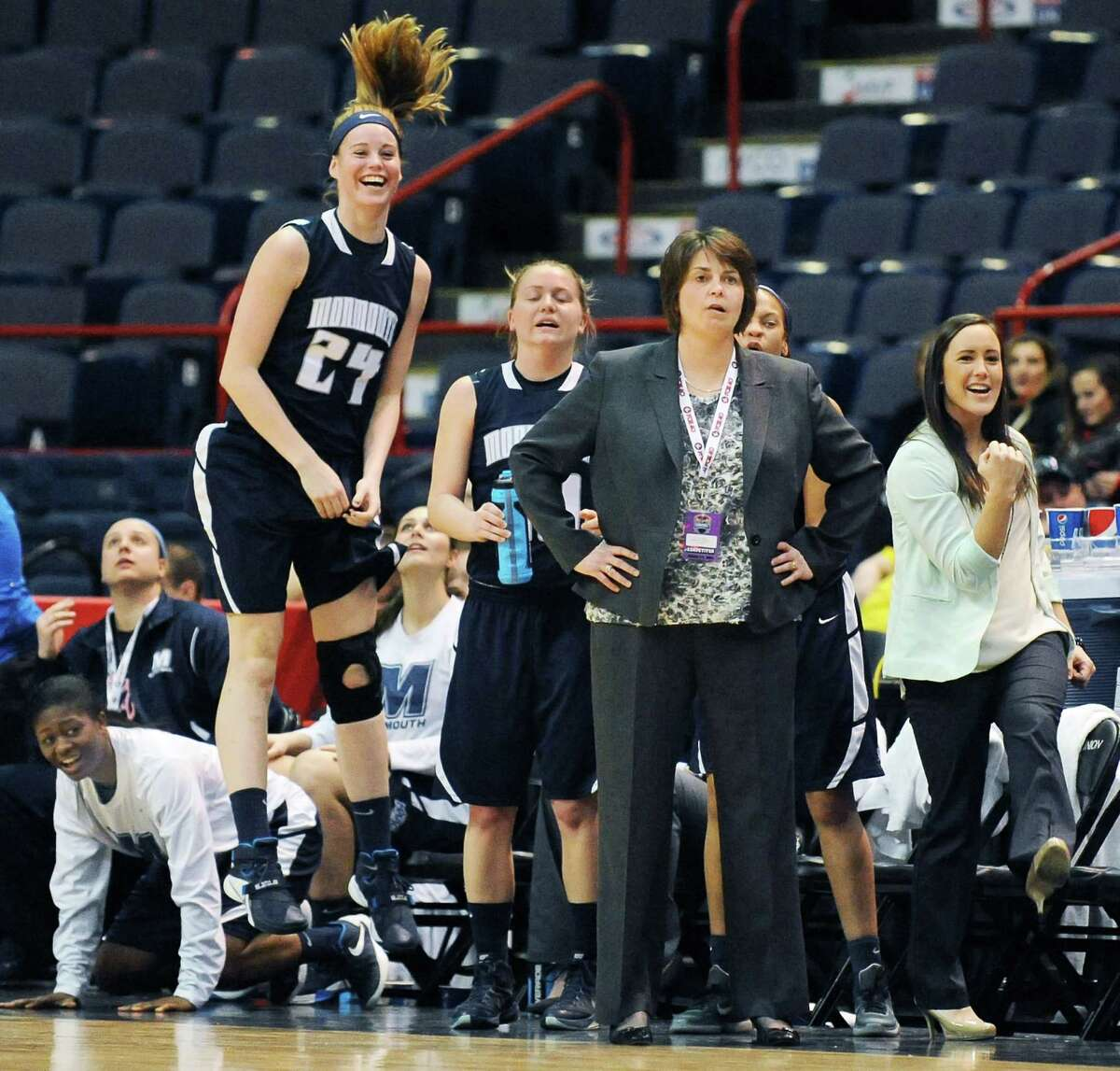 Monmouthhead coach Jenny Palmateer, center, and her bench watch at action during Saturday's MAAC women's quarterfinal against Fairfield at the Times Union Center Saturday March 5, 2016 in Albany, NY. (John Carl D'Annibale / Times Union)