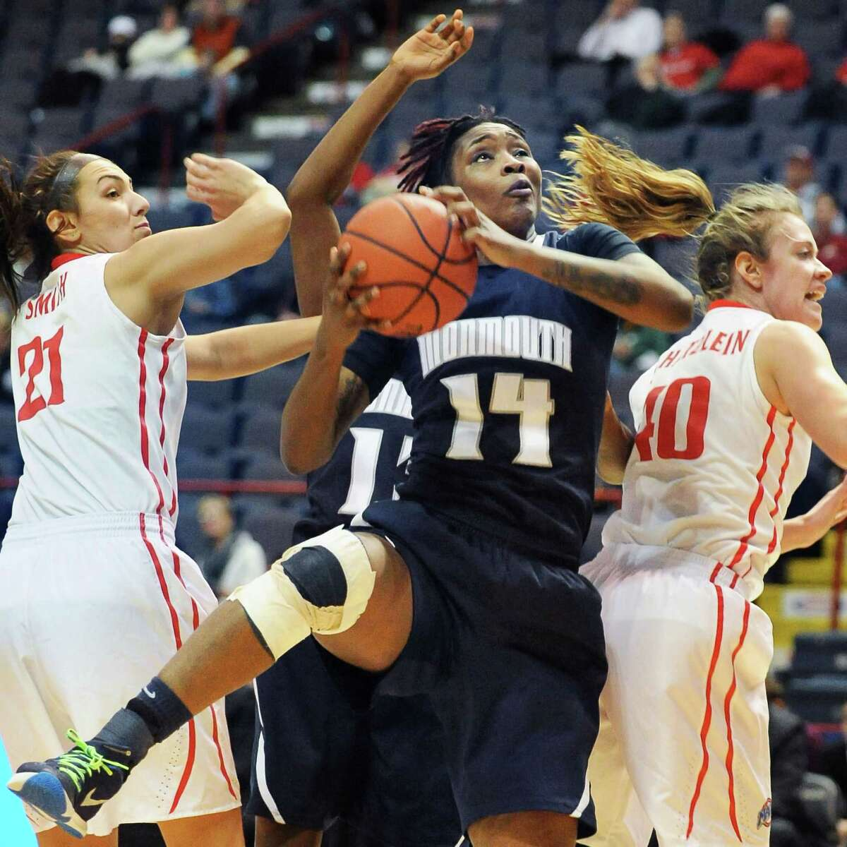 Monmouth's # 14 Christina Mitchel beats out Fairfield's #21 Casey Smith , left, and #40 Kristin Schatzlein, right, to a rebound during their MAAC women's quarterfinal at the Times Union Center Saturday March 5, 2016 in Albany, NY. (John Carl D'Annibale / Times Union)