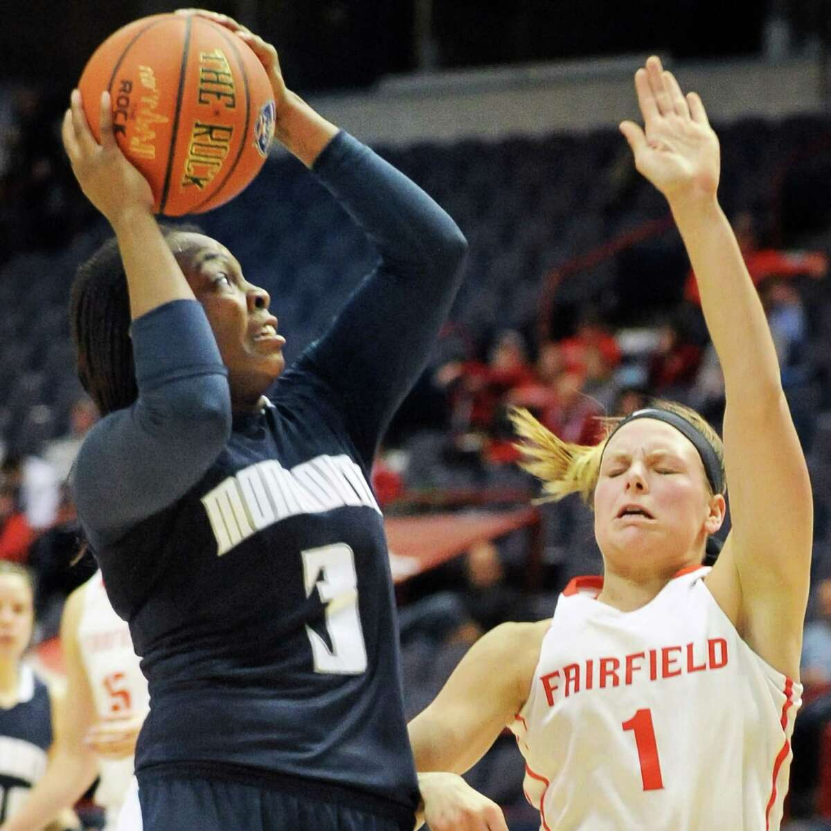 Monmouth's # 3 Jasmine McCall, left, gets a shot over Fairfield's #1 Lizzy Ball during their MAAC women's quarterfinal at the Times Union Center Saturday March 5, 2016 in Albany, NY. (John Carl D'Annibale / Times Union)