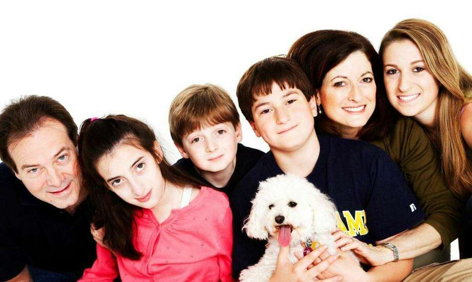 The Marella family, from left, is made up of father Phil; daughter Dana, 16; sons Andrew, 10 and Philip, 13; mom Andrea and daughter Julia, 18; and one of their two dogs, Lacy. Dana and Andrew both have Niemann-Pick Type C, a rare genetic affliction, that usually affects shool-aged children by interfering with their ability to metabolize cholesterol. Photo: Venture Photography/Contributed Photo, Contributed Photo / Greenwich Citizen