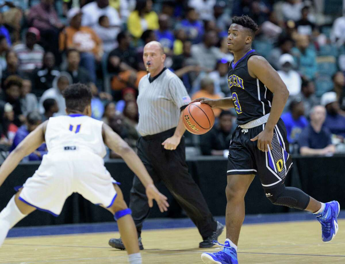 Joshua Boyd (3) of the Beaumont Ozen Panthers brings the ball up the court in the first half against the Elkins Knights in high school basketball's 5A Region III finals on Saturday, March 5, 2016 at the Merrell Center.