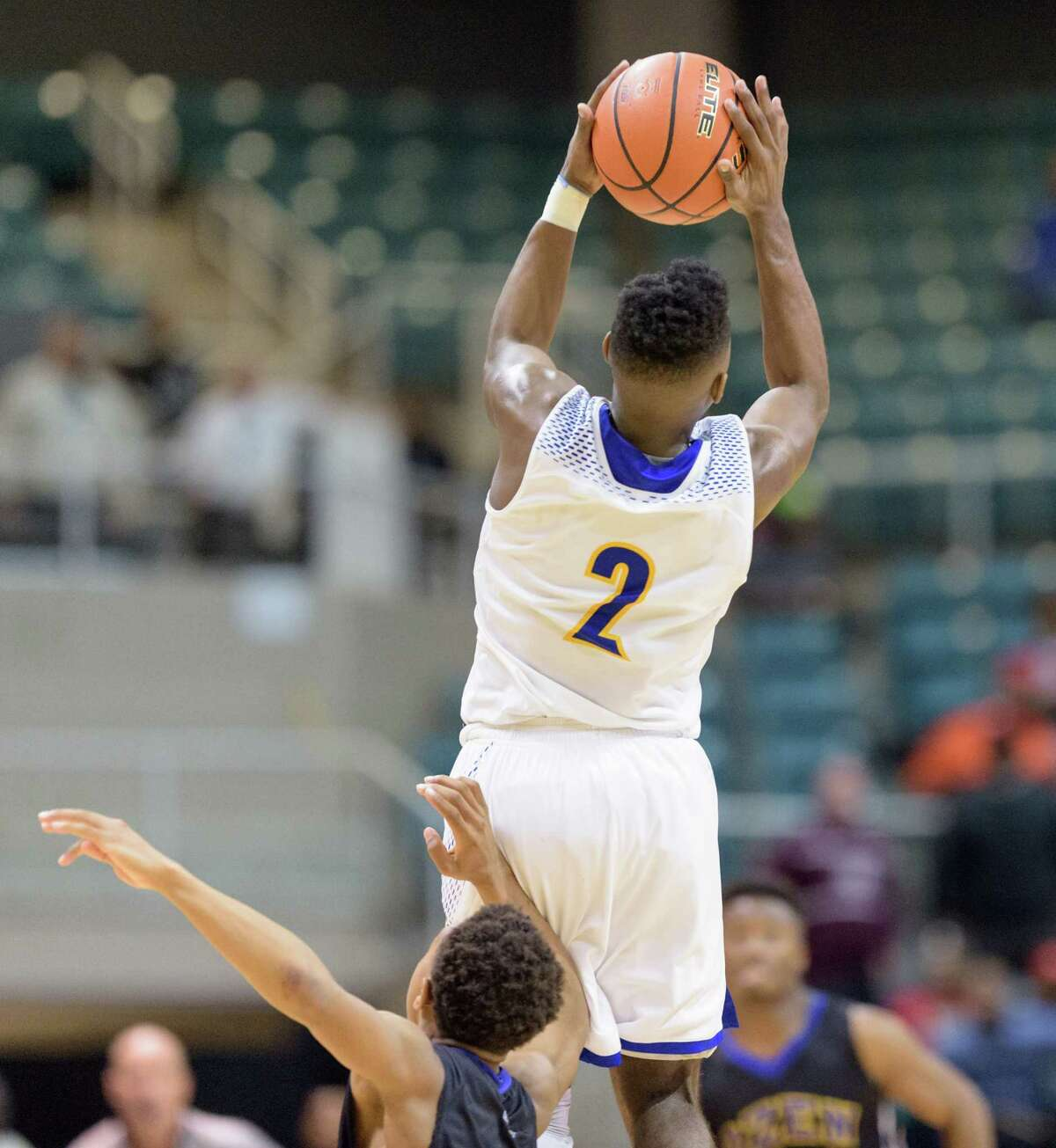 Ken Busby (2) of the Elkins Knights grabs a long pass in the second half against the Beaumont Ozen Panthers in high school basketball's 5A Region III finals on Saturday, March 5, 2016 at the Merrell Center.
