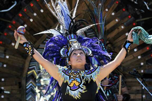 Marisela Orozco, a member of Dance Azteca Taxcayolotl, performs a ritual to bless Smither Park, pictured, and The Orange Show Saturday, March 5, 2016, in Houston. The annual event was designed to bring another good year for the two places.