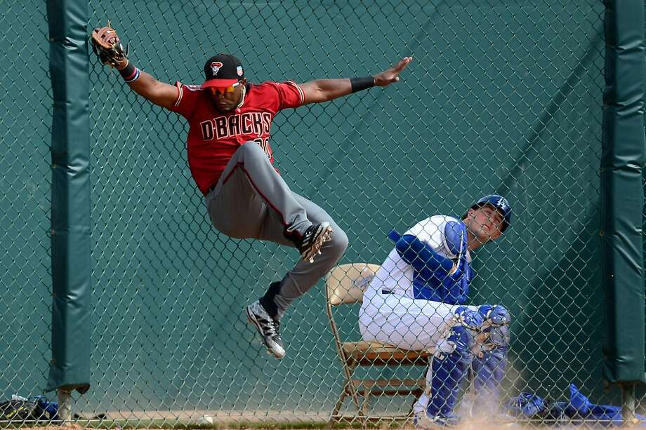 Socrates Brito of the Arizona Diamondbacks catches a fly ball in the fifth inning of the spring training game against the Los Angeles Dodgers.  Photo: Jennifer Stewart, Getty Images