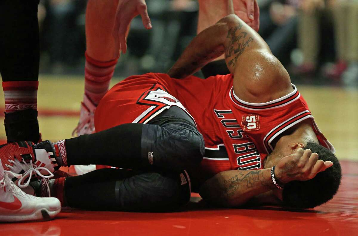 CHICAGO, IL - MARCH 05: Derrick Rose #1 of the Chicago Bulls lies on the floor after hitting the ground hard against the Houston Rockets at the United Center on March 5, 2016 in Chicago, Illinois. NOTE TO USER: User expressly acknowledges and agrees that, by downloading and or using the photograph, User is consenting to the terms and conditions of the Getty Images License Agreement.