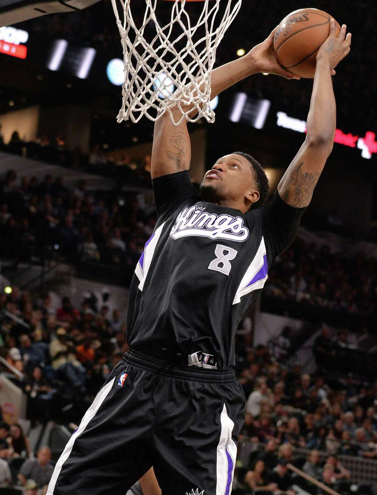 Sacramento Kings forward Rudy Gay dunks during the first half of an NBA basketball game against the San Antonio Spurs, Saturday, March 5, 2016, in San Antonio.