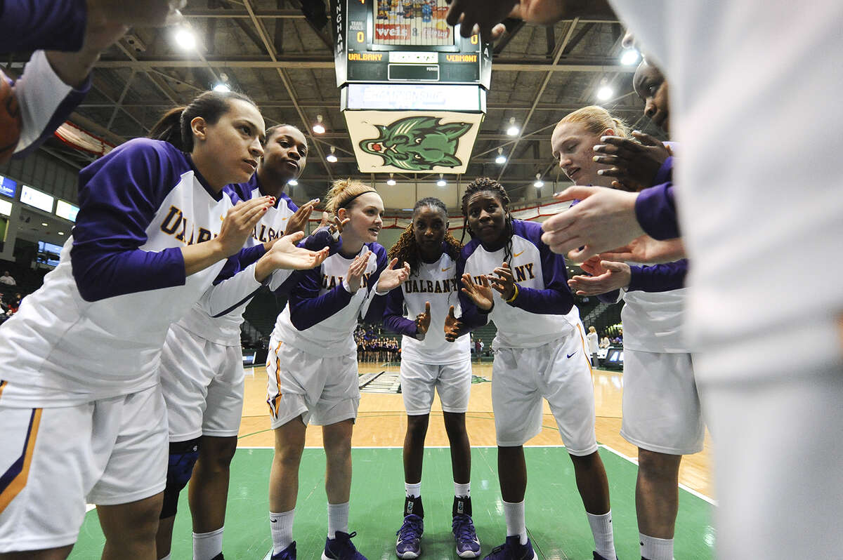 The UAlbany women's basketball team huddles at its game with Vermont in the America East Tournament. (Steve McLaughlin / Special to the Times Union)