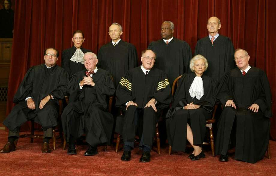 WASHINGTON - DECEMBER 5:  US Supreme Court Justices (L-R, Seated) Associate Justice Antonin Scalia, Associate Justice John Paul Stevens, Chief Justice William H. Rehnquist, Associate Justice Sandra Day O'Connor, Associate Justice Anthony M. Kennedy, (L-R, Standing) Associate Justice Ruth Bader Ginsburg, Associate Justice David H. Souter, Associate Justice Clarence Thomas and Stephen G. Breyer pose for pictures at the US Supreme Court December 5, 2003 in Washington, DC.  (Photo by Mark Wilson/Getty Images) Photo: Mark Wilson, Getty Images / 2003 Getty Images