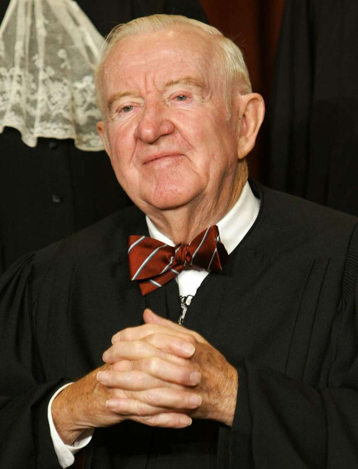 WASHINGTON - DECEMBER 5: US Supreme Court Associate Justice John Paul Stevens poses for a picture at the US Supreme Court December 5, 2003 in Washington, DC. (Photo by Mark Wilson/Getty Images)