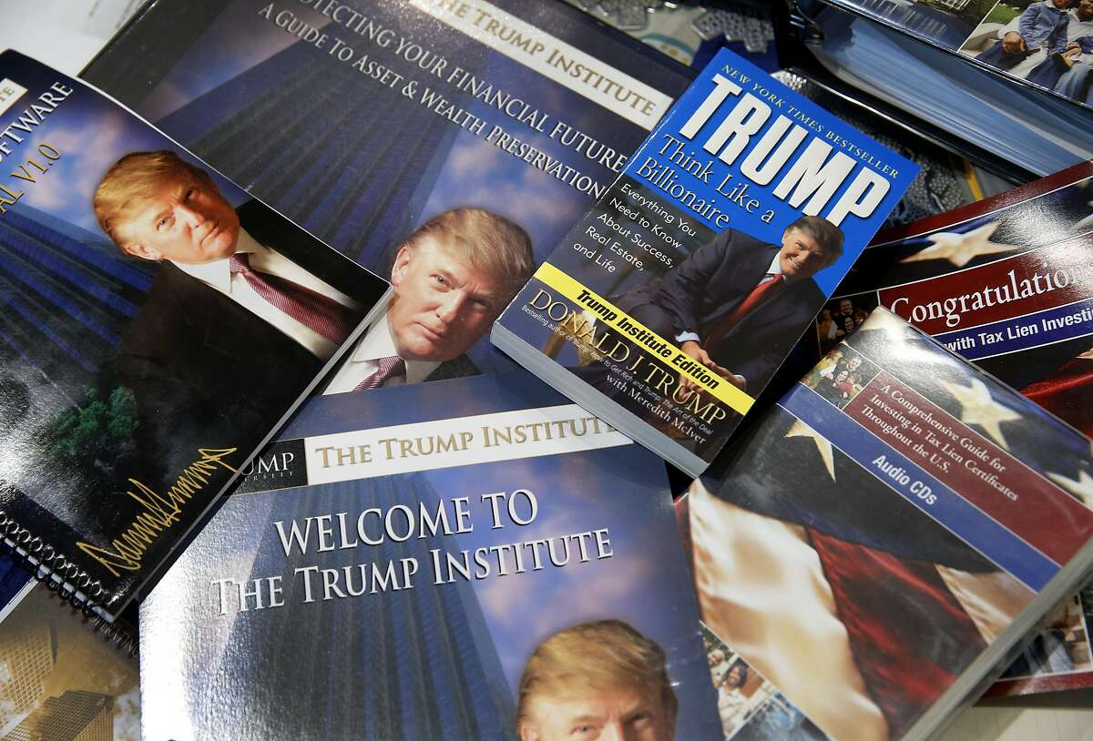 """Felicisimo and Elaine Limon display material they received from Trump University at their home in El Sobrante, Calif. on Saturday, March 5, 2016. The Limons paid more than $35,000 to attend """"Trump University"""" a number of years ago, believing that those who attended the seminars would get rich in real estate. Instead, they lost their money, went into debt, and nearly lost their house. Now they are part of a class-action lawsuit in California against the GOP presidential front runner."""