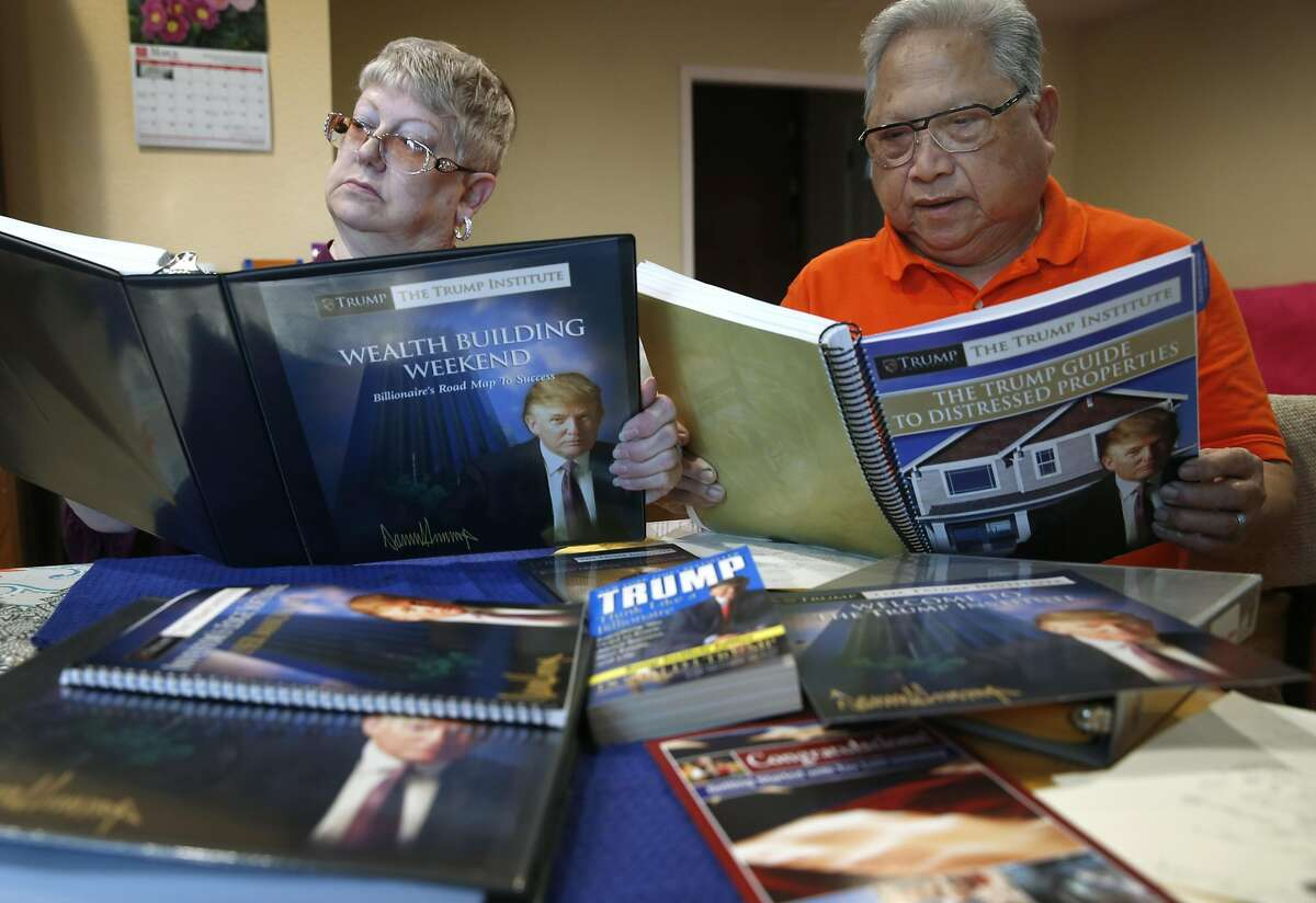 """Felicisimo and Elaine Limon review material from Trump University at their home in El Sobrante, Calif. on Saturday, March 5, 2016. The Limons paid more than $35,000 to attend """"Trump University"""" a number of years ago, believing that those who attended the seminars would get rich in real estate. Instead, they lost their money, went into debt, and nearly lost their house. Now they are part of a class-action lawsuit in California against the GOP presidential front runner."""