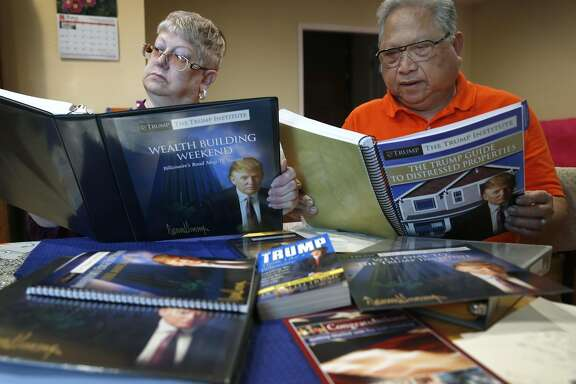 "Felicisimo and Elaine Limon review material from Trump University at their home in El Sobrante, Calif. on Saturday, March 5, 2016. The Limons paid more than $35,000 to attend ""Trump University"" a number of years ago, believing that those who attended the seminars would get rich in real estate. Instead, they lost their money, went into debt, and nearly lost their house. Now they are part of a class-action lawsuit in California against the GOP presidential front runner."