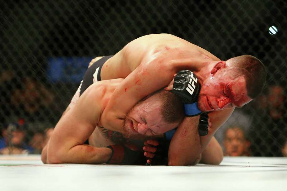 LAS VEGAS, NV - MARCH 5:  Nate Diaz applies a choke hold to win by submission against Conor McGregor during UFC 196 at the MGM Grand Garden Arena on March 5, 2016 in Las Vegas, Nevada. Photo: Rey Del Rio, Getty Images / 2016 Rey Del Rio