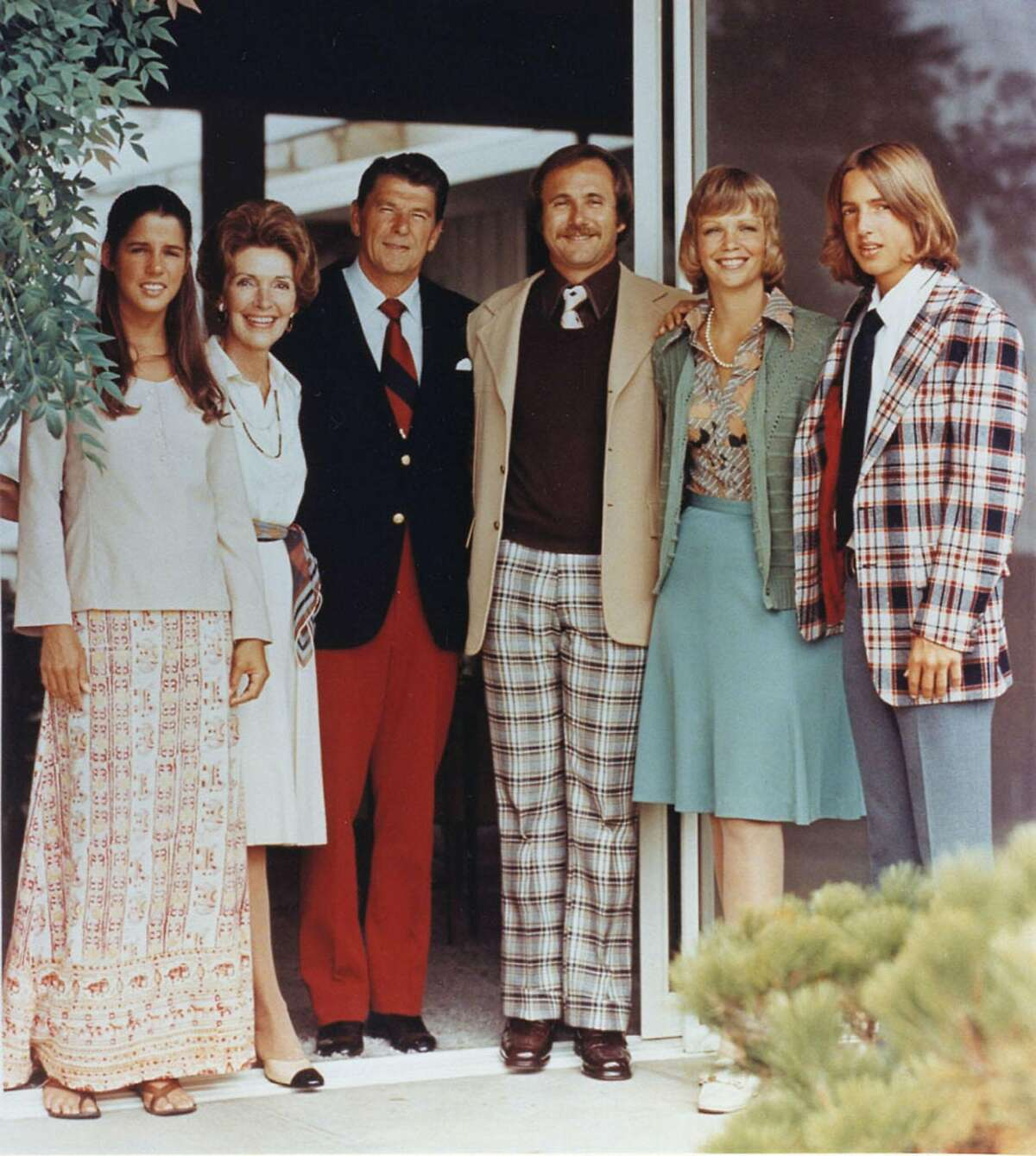 United States president Ronald Reagan and wife Nancy and the Reagan children are shown in this 1976 photograph outside Reagan's Pacific Palisades house. Shown (L-R) are Patti, Nancy Reagan, Ronald Reagan, Michael Reagan, Maureen Reagan and Ron Reagan.