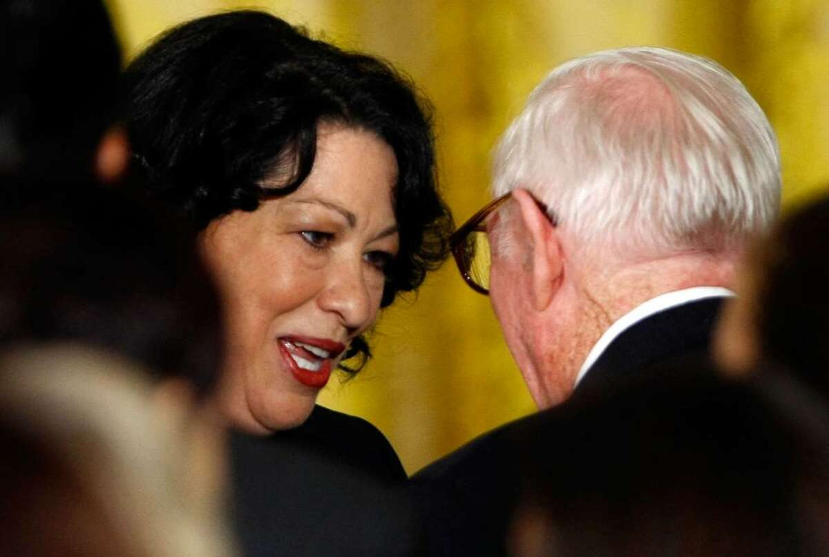 WASHINGTON - AUGUST 12: Supreme Court Justice Sonia Sotomayor (L) talks with Supreme Court Justice John Paul Stevens (R) during a reception in her honor at the White House August 12, 2009 in Washington, DC. Sotomayor was sworn in as the first Hispanic Supreme Court Justice August 8, 2009. (Photo by Win McNamee/Getty Images)