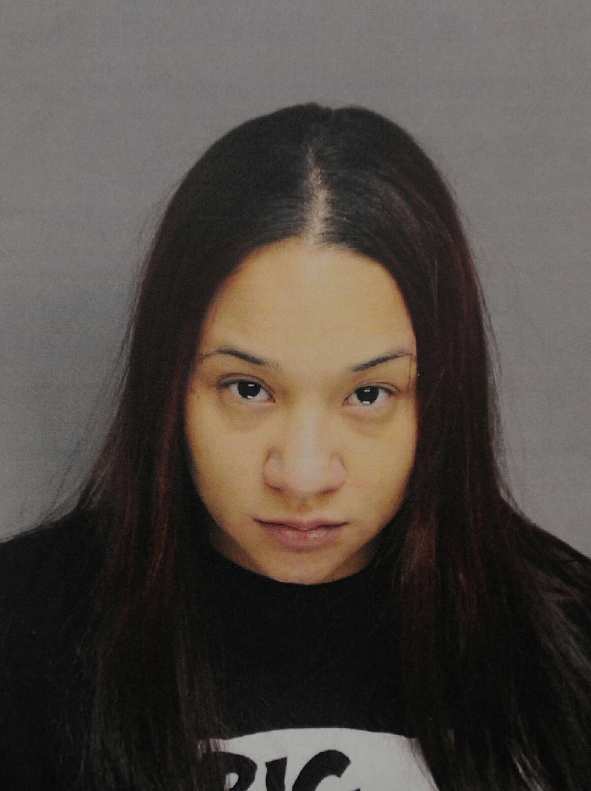 Vivian Rodriguez, one of two suspects arrested on a variety of drug and weapons charges following a police raid on their apartment at 109 George Street in Bridgeport, Conn. Large quantities of drugs, cash, ammunition, and two cars were seized by police.
