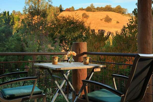 A deck overlooking the Madrone Garden at Eden Vale Inn.