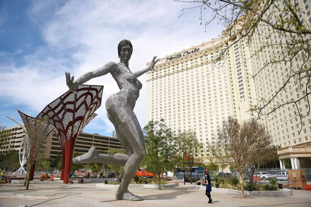 """Marco Cochrane's sculpture """"Bliss Dance"""" is seen after being installed in MGM Resorts International's new dining and entertainment district, The Park, Friday, March 4, 2016, in Las Vegas. The 40-foot tall statue, which debuted at Burning Man in 2010, serves as a visual focal point for The Park, which is located between Monte Carlo, New York New York and the new T-Mobile Arena."""