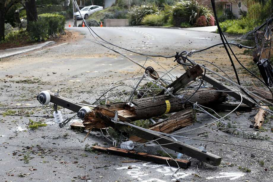 Downed power lines and a broken pole block Via Roble in Lafayette, California, on Sunday, March 6, 2016. Photo: Connor Radnovich, The Chronicle