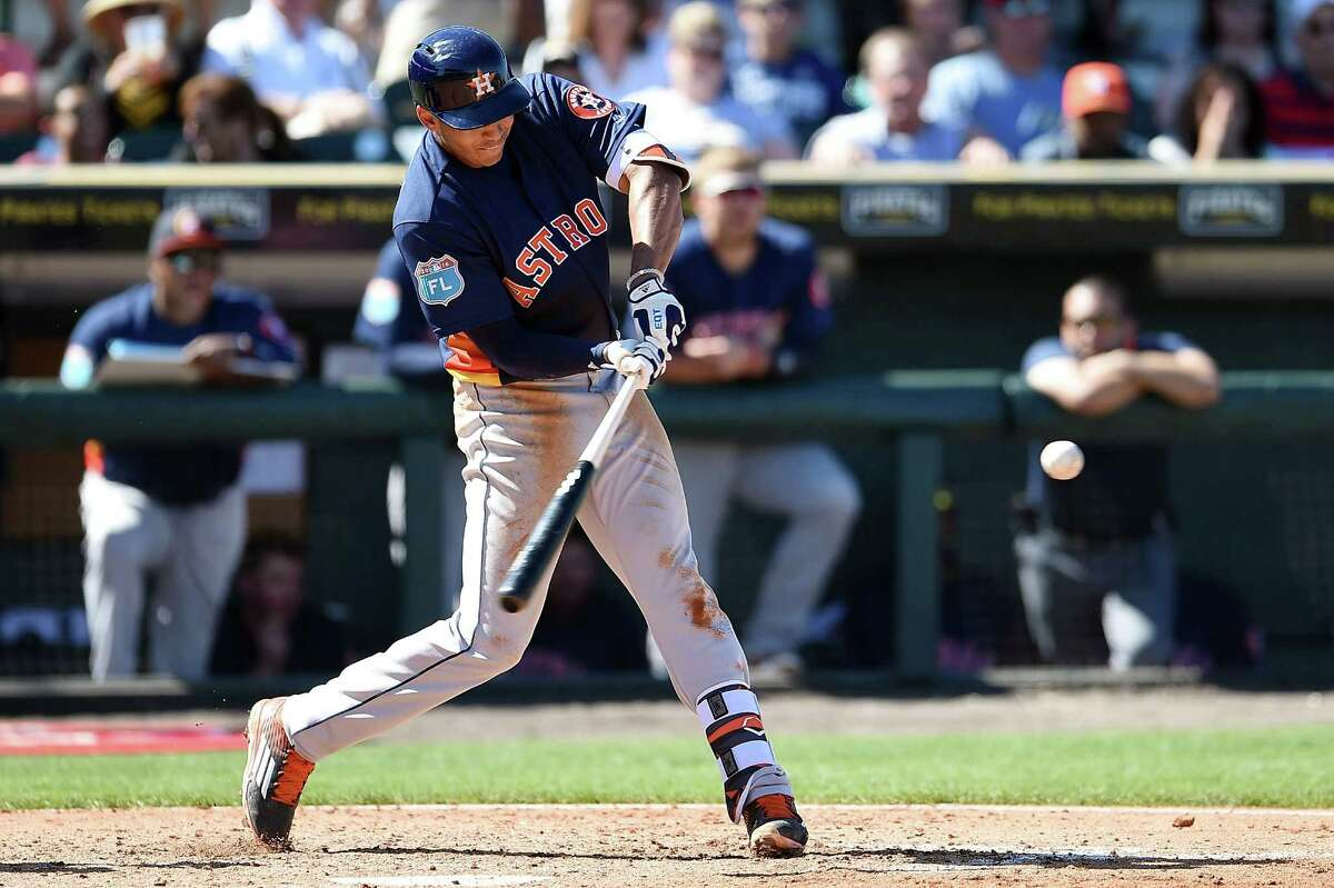 BRADENTON, FL - MARCH 06: Carlos Correa #1 of the Houston Astros swings at a pitch during the fifth inning of a spring training game against the Pittsburgh Pirates at McKechnie Field on March 6, 2016 in Bradenton, Florida.
