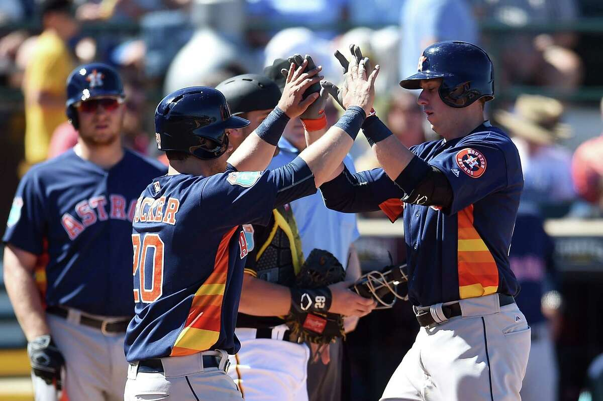BRADENTON, FL - MARCH 06: Matt Duffy #19 of the Houston Astros is congratulated by Preston Tucker #20 following a fourth inning home run against the Pittsburgh Pirates during a spring training game at McKechnie Field on March 6, 2016 in Bradenton, Florida.