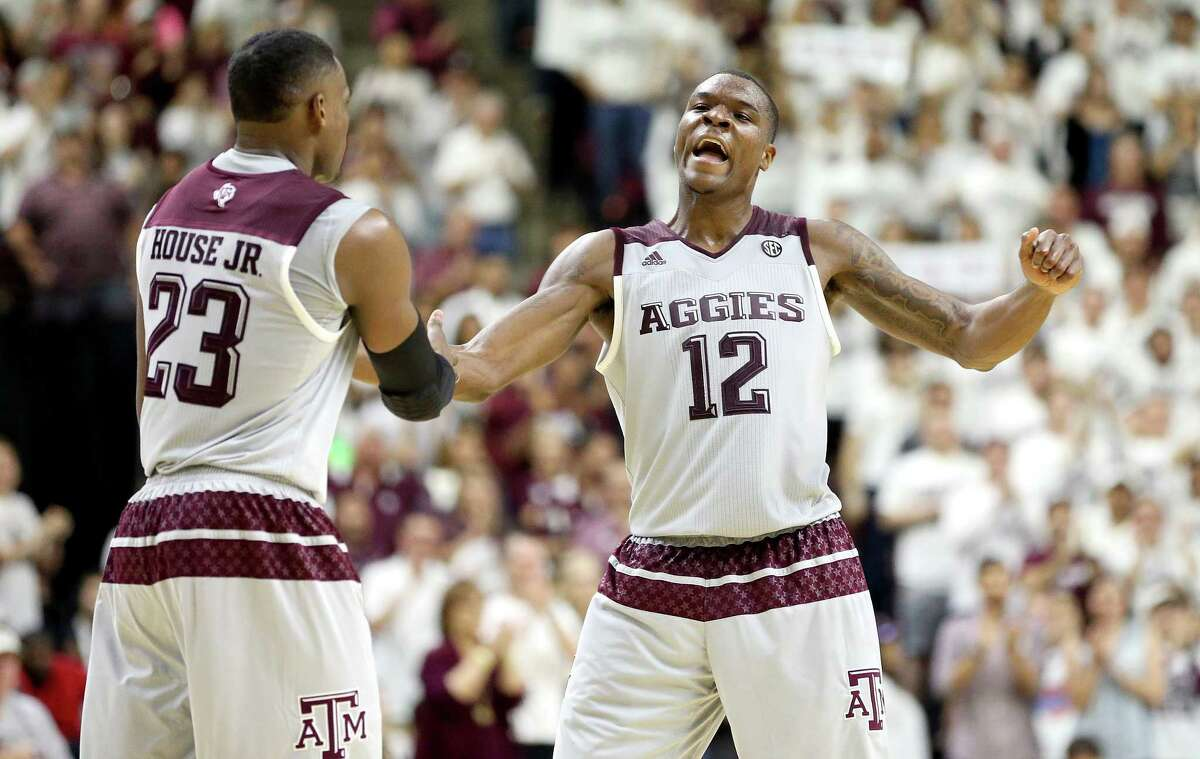 Texas A&M's Jalen Jones (12) reacts with teammate Danuel Jones (23) as timeout is called against Vanderbilt during the second half of an NCAA college basketball game, Saturday, March 5, 2016, in College Station, Texas. Texas A&M won 76-67.