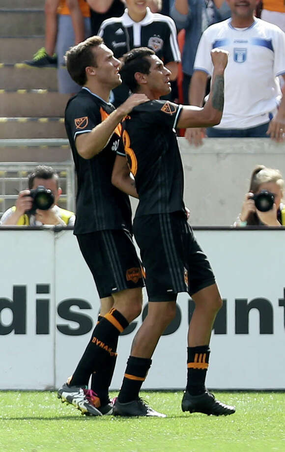 Houston Dynamo midfielder Cristian Maidana (8) celebrates wit teammate Houston Dynamo forward Andrew Wenger (11) after scoring a goal against the New England Revolution in the first half at BBVA Compass Stadium Sunday, March 6, 2016, in Houston. Photo: Gary Coronado Gary Coronado, Houston Chronicle / © 2015 Houston Chronicle