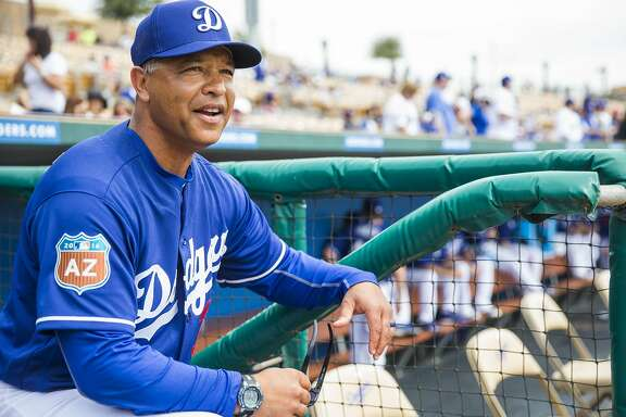 GLENDALE, AZ - MARCH 03: Los Angeles Dodgers manager Dave Roberts looks on during a spring training game against the Chicago White Sox at Camelback Ranch on March 3, 2016 in Glendale, Arizona. (Photo by Rob Tringali/Getty Images)