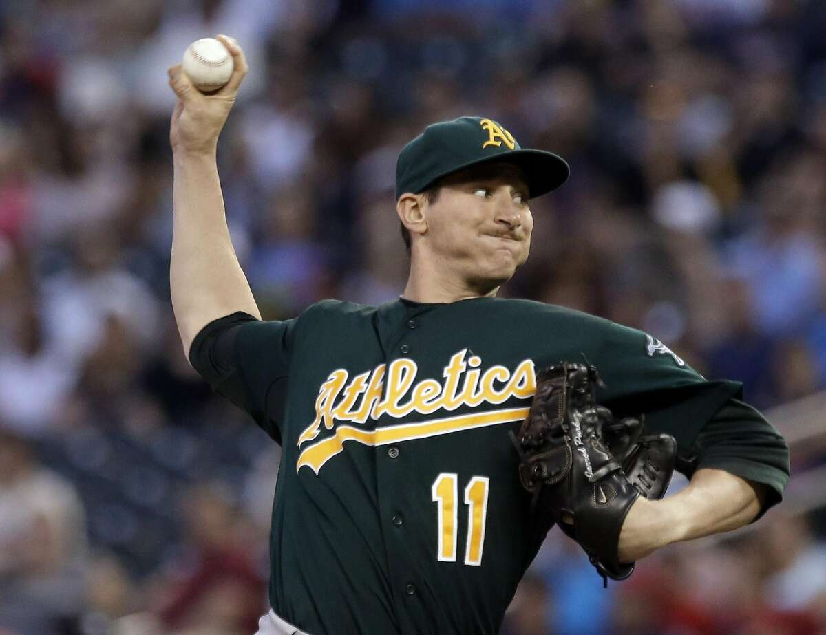 FILE - In this Sept. 10, 2013, file photo, Oakland Athletics pitcher Jarrod Parker throws against the Minnesota Twins during a baseball game in Minneapolis. Parker is uncertain about the protocol for his recovery from a fractured elbow following two Tommy John surgeries, and that�s probably because he might just be the new case study for a pitcher who has undergone all of those operations. (AP Photo/Jim Mone, File)