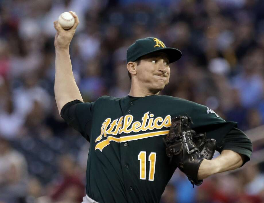 FILE - In this Sept. 10, 2013, file photo, Oakland Athletics pitcher Jarrod Parker throws against the Minnesota Twins during a baseball game in Minneapolis.  Parker is uncertain about the protocol for his recovery from a fractured elbow following two Tommy John surgeries, and that�s probably because he might just be the new case study for a pitcher who has undergone all of those operations. (AP Photo/Jim Mone, File) Photo: Jim Mone, Associated Press