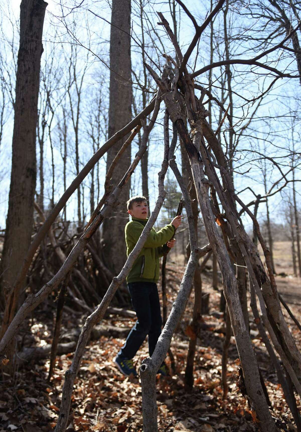 Isaac Saunderi, 11, of Stamford, constructs a survival shelter during the Family Nature Play Series at Audubon Greenwich in Greenwich, Conn. Sunday, March 6, 2016. Taught by Education Coordinator Susan Matthews, families learned how to collect sticks to build a campfire and build a survival lean-to shelter. The Family Nature Play Series occurs on the first Sunday of every month and provides hands-on, educational activities for children and parents. The next two sessions will be wildlife tracking and a sensory nature hike.