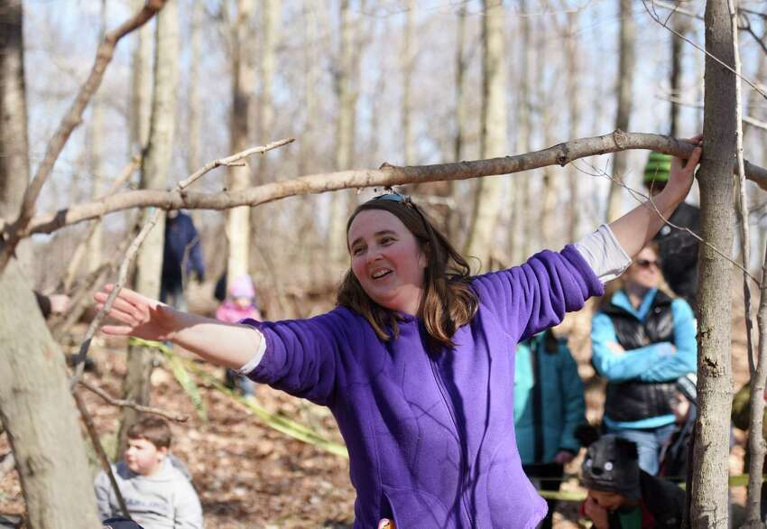 Education Coordinator Susan Matthews demonstrates how to build a survival shelter during the Family Nature Play Series at Audubon Greenwich in Greenwich, Conn. Sunday, March 6, 2016. Families learned how to collect sticks to build a campfire and build a survival lean-to shelter. The Family Nature Play Series occurs on the first Sunday of every month and provides hands-on, educational activities for children and parents. The next two sessions will be wildlife tracking and a sensory nature hike.