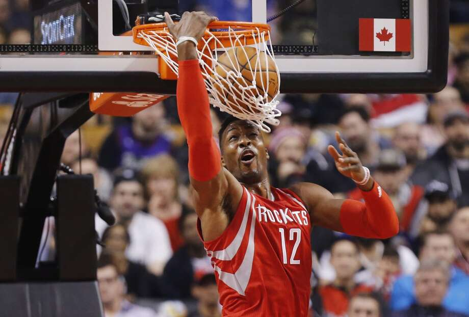 Houston Rockets' Dwight Howard (12) dunks on the Toronto Raptors during first half NBA basketball action in Toronto on Sunday, March 6, 2016. (Mark Blinch/The Canadian Press via AP) MANDATORY CREDIT Photo: Mark Blinch, Mark Blinch/ The Canadian Press