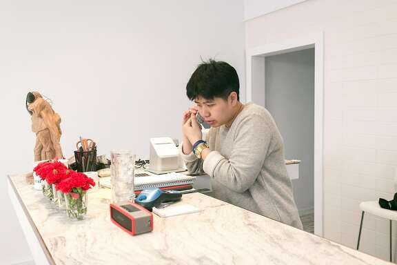 Co-owner Mu Chanma takes a phone order at Thoughts Style Cuisine Showroom in S.F.