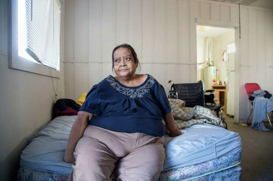 Belinda Hernandez, 50, will go on trial in April almost four years after being arrested and charged with felony child neglect.  poses for a portrait in her apartment Thursday, Dec. 17, 2015, in Houston. Hernandez said she developed a severe infection in the Harris County Jail, where she was held for more than a year.  ( Jon Shapley / Houston Chronicle ) Photo: Jon Shapley, Staff / © 2015  Houston Chronicle