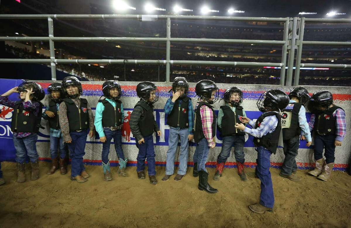 Mutton Bustin performers wait their turn at the Houston Rodeo Sunday, March 6, 2016, in Houston.