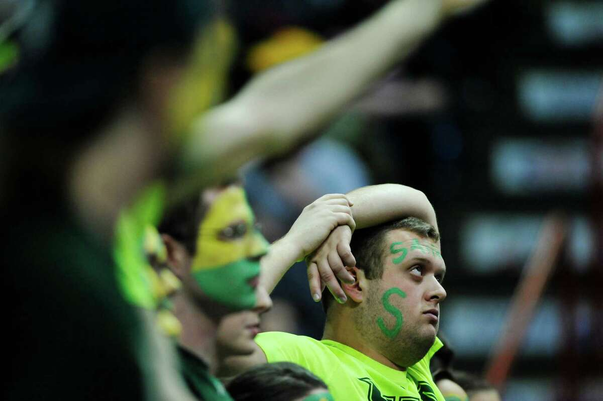Siena fans watch the final seconds tick away as their team loses to Iona in their MAAC Tournament game on Sunday, March 6, 2016, in Albany, N.Y. (Paul Buckowski / Times Union)