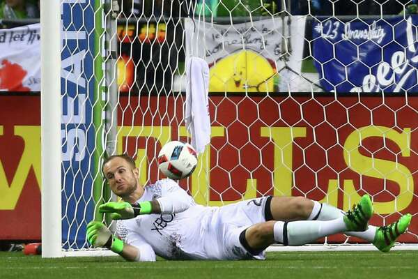 The ball slips past Seattle Sounders FC goal keeper Stefan Frei as Sporting Kansas City's Nuno Andre Coelho scored the only goal of the game in the second half of the Sounders' MLS season opener versus Sporting Kansas City on March 6, 2016 at CenturyLink Field.